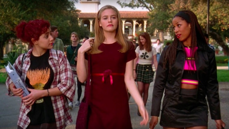 Cher from Clueless walking proudly with her friends
