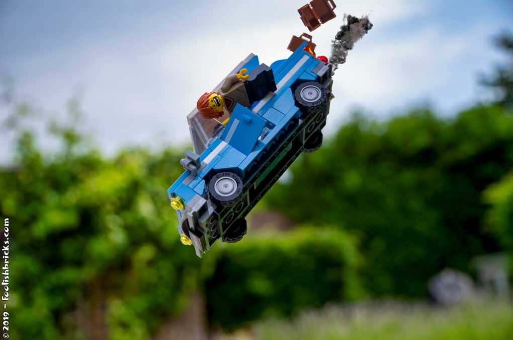 LEGO vehicle flying ogg a cliff
