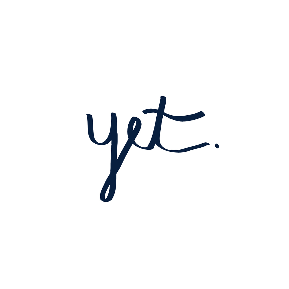 "The word ""Yet"" written in cursive"